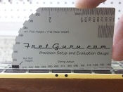 fretguru.com's string height gauge.  Know how high the strings are before you buy.